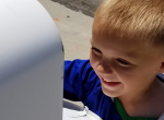 Child looking in mailbox - Adventures in NanaLand