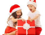 Excited kids opening red box wearing Santa hats - Adventures in NanaLand