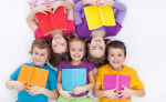 5 kids laying on the ground reading books, subscription boxes for kids, Adventures in NanaLand
