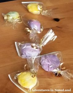 Magic Rainbow Rocks in plastic bags tied with gold bow - Adventures in NanaLand